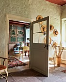 Old hats and walking sticksand door with glass panels in hallway