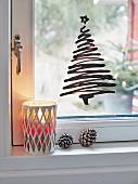 A Christmas tree drawn on a window