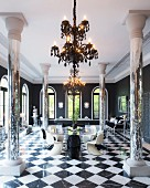 Mirrored pillars, billiards table, round glass table and classic designer pieces