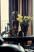 Daffodils and various ethno figures on coffee table