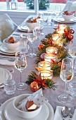 A festively set table with a Christmas candle decoration