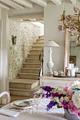View from dining area to stone staircase with stone wall