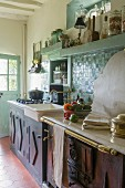 Vintage-style country-house kitchen with turquoise wall tiles