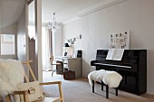 Sheepskin on piano stool, black piano and vintage desk and office chair