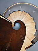 View down spiral staircase made from metal and wood