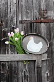Hen motif on zinc tray and tulips on wooden door
