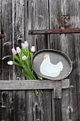 Hen motif on zinc tray and tulips on wooden door