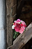 Bouquet of carnations tied with grasses