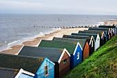 Colourful beach huts on Suffolk beach