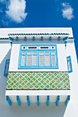 White and blue Tunisian facade with ornate bay window