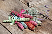 Hand-made lavender wands and lavender on wooden surface