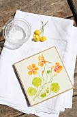 Coaster painted with floral motif
