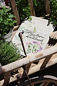 Book cover embroidered with floral motifs in vintage pull-along cart