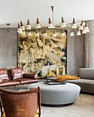 Large modern artwork in lounge area with 50s lamps
