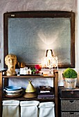Chalkboard above open-fronted shelves in Mediterranean kitchen