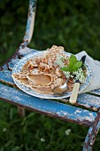 Pancakes filled with apple sauce on vintage-style plate