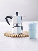 Espresso pot on trivet made from clothes pegs