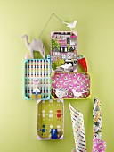 Colourful shelving made from fruit crates painted brightly and with bases covered in decorative paper