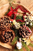 Rustic Christmas arrangement on wooden dish (top view)