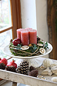 Rustic Advent wreath with red candles on cake stand