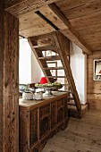 Rustic wooden staircase and antique trunk in chalet