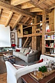 Living area with rustic gallery in chalet