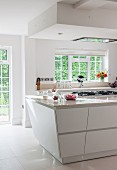 Tapered island counter in white, modern kitchen