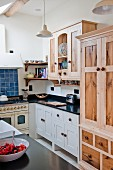 Stripped wooden cabinet in country-house kitchen
