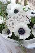 Hand-written tag amongst anemones arranged in soup tureen