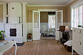 Tiled stove and double doors in classic living room
