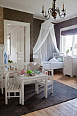 Vintage-style nursery with brown wallpaper