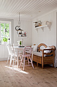 Country-house-style dining room with wood-clad walls