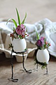 Flowers arranged in blown eggs on wire legs