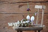 Flowers arranged in goose eggs in egg carton