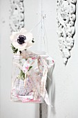 Screwtop jar decorated with rag strips and anemone