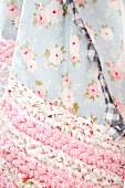 Floral blanket with crocheted, rag-yarn edge