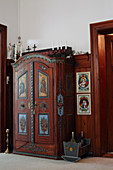 Old farmhouse cupboard with decoratively painted doors
