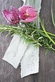 Rosemary sprig, name on ribbon and snake's head fritillary