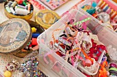 Various trims and ribbons in storage box