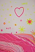 Wall decorated with heart and stars made from washi tape