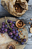 Black grapes and apricot stones