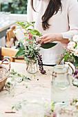 Woman arranging autumnal bouquet