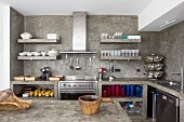 Open shelves and rustic wooden containers in kitchen with moulded concrete elements