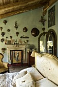 Collection of birds' nests on wall of elegant bedroom with vintage ambiance
