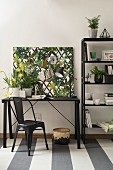 Black furniture and jungle-print pinboard in study