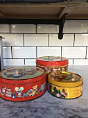 Old biscuit tins before a makeover