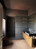 Floor-level shower and grey marble elements in purist bathroom