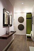 Pictures and circular wall decorations in modern hall