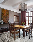 Classic, dark-wood furniture in dining room