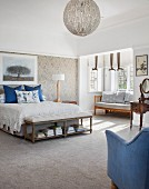 Spacious, country-style bedroom with blue accents